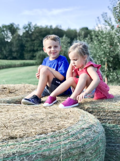 Kids on a hay bale