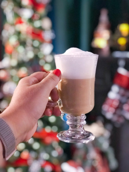 hot cocoa in front of christmas tree